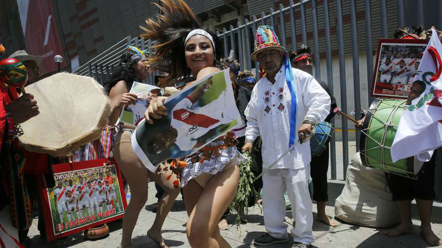 Shamans, witch doctors and dancers, perform a rite in an attempt to bring good luck to Peru's national soccer team. (Photo / AP)
