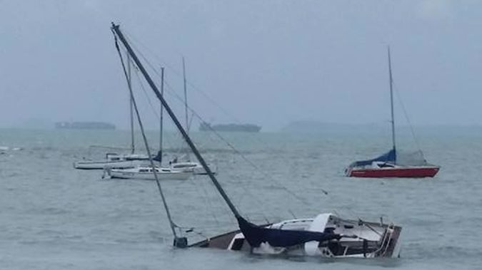 Rough seas were playing havoc with boats at Waiake Beach on Auckland's North Shore last night. (Photo / Supplied)