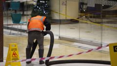 Contractors clean up food oil spill at Elliott food court in Auckland.