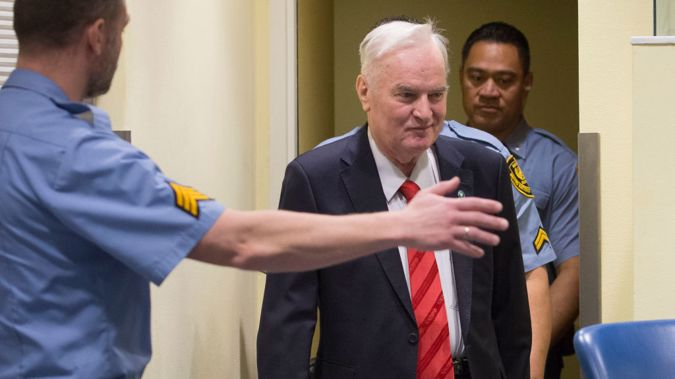 Former Bosnian military chief Ratko Mladic appears in the International Criminal Tribunal charged with genocide, war crimes and crimes against humanity. (Photo \ Getty Images)