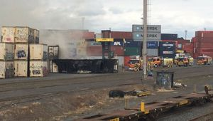 A container smoulders after firefighters put out the blaze. (Photo: Supplied)