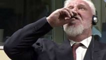 Bosnian war criminal dies after drinking poison in court
