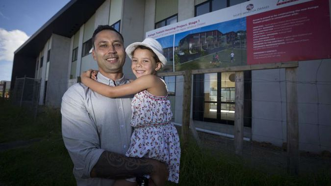 Spokesperson Ngarimu Blair with his daughter outside housing development on Ngati Whatua land in Orakei. (Photo/Dean Purcell)