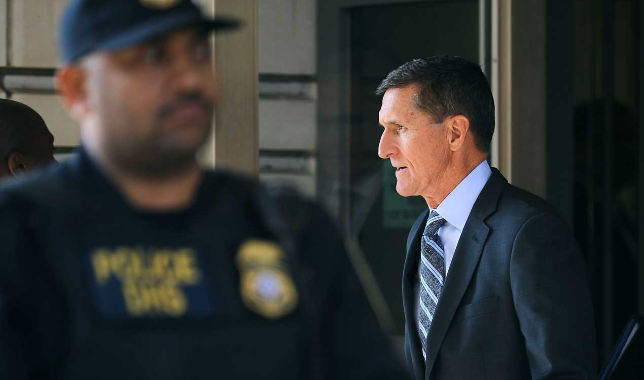 Flynn walks out of a federal courthouse in Washington to chants of 'Lock him up' (Getty Images)