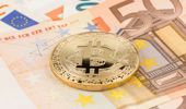 Would you buy into Bitcoin? Is this a bubble that will burst? (Photo \ Getty Images)