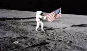 Apollo 12 Astronaut Charles 'Pete' Conrad Stands Beside The U.S, Flag After It Was Unfurled On The Lunar Surface On November, 19, 1969. (Photo \ Getty Images)