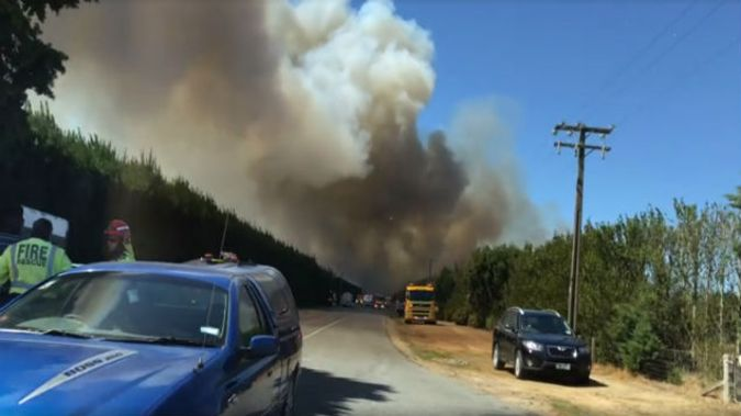 Two houses were destroyed in the fast moving fire, and firefighters will probably be there all day. (Photo: Ashburton TV)