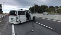 Delays after car hits barrier on Auckland motorway