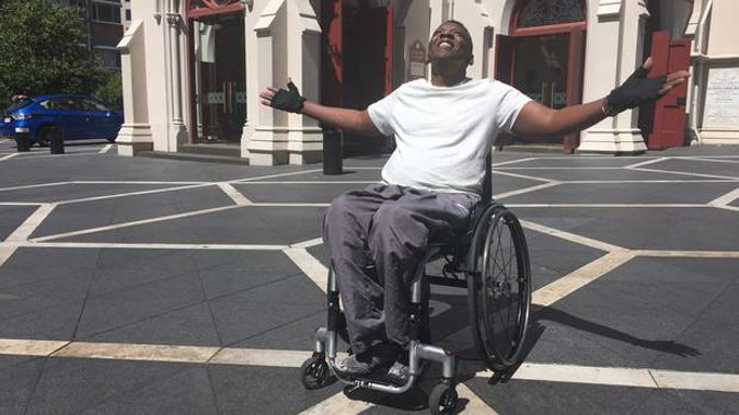 Paraplegic Silice Karito has been reunited with his wheelchair after a nightmare 48 hours stuck in a hotel room. (Photo / NZ Herald)