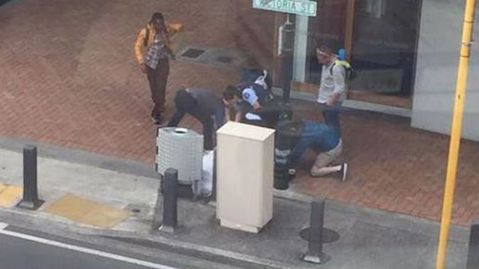 Members of the public were quick to assist an overpowered cop as she arrested a man much larger than herself. (Photo / Facebook)