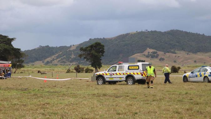 Witnesses reported seeing debris fly off the northward-bound plane about a kilometre before it plunged into a paddock alongside the Northern Wairoa River. (Photo/ NZ Herald)