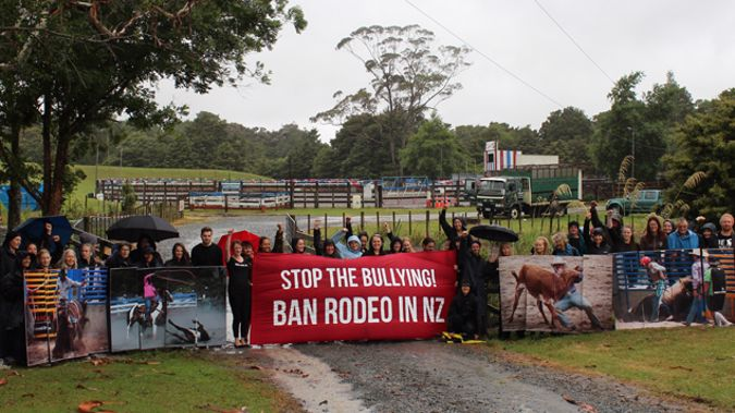 Animal right protestors gathered outside the 45th rodeo event in Warkworth today. (Photo/ Supplied)