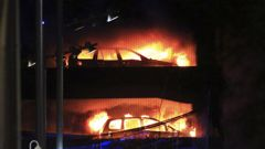 Vehicles burn during a blaze at a multi-storey car park at the Echo Arena on the waterfront in Liverpool. (Photo / AP)