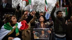 Anti-regime protestors demonstrate outside the Iranian embassy in London, England. Protests in Iran have seen at least 12 people die during violent clashes over recent days. (Photo / Getty Images)