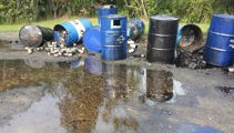 Piha residents angry after leaking oil barrels dumped in car park