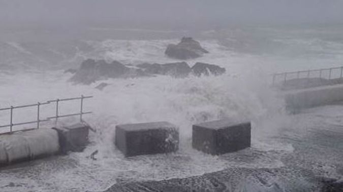 Massive swells have pushed over seawall blocks on State Highway One north of Kaikoura, delaying the road's opening (Image - NZTA)