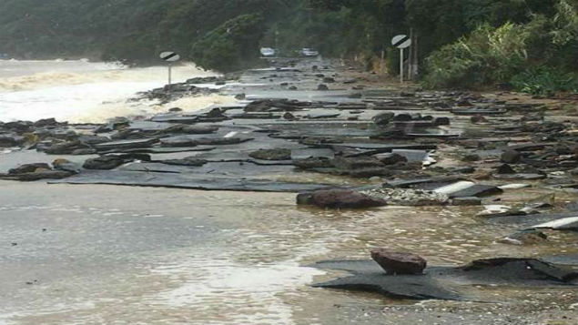 The Thames Coast Rd was severely damaged in last week's storm to hit New Zealand. (Photo \ Thames District Fire Brigade)