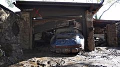 A car sits parked in the garage of a home that was damaged by a mudslide. (Photo / Getty Images)
