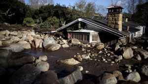 Debris from a mudslide covers a home on January 10, 2018 in Montecito, California. (Photo \ Getty Images)