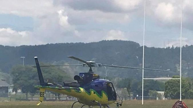 A helicopter has just arrived at the rugby club. (Photo / Victoria Logan)