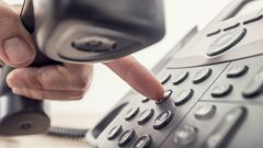 Landlines are on the decline, but some people are hanging on to them to access high-speed broadband. (Photo/ Getty)