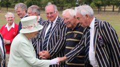 Ron Brierley in 2015 (second from right) meeting the Queen, who has accepted his resignation as a Knight. (Photo / Supplied)