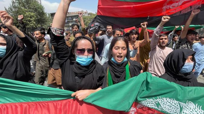 A group of people march with Afghan flags during the Afghanistan's Independence Day rally in Kabul, Afghanistan. (Photo / AP)