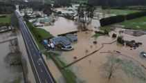 Wild weather escapes: Baby rescued by boat; residents, animals flee raging floodwaters