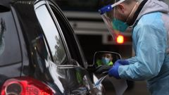 A health worker prepares a Covid-19 test at a drive-through testing clinic in Fairfield, Melbourne on July 9. Photo / Getty Images