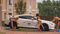 Real estate ad with bikini clad girls washing car slammed