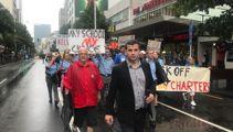 Protest against charter school closures draws crowd, despite rain
