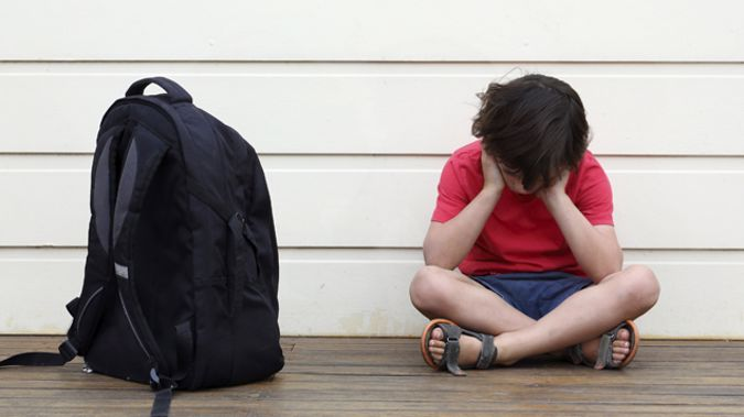 He says his son was bullied almost daily, and was sometimes kicked and punched. (STOCK photo \ iStock)