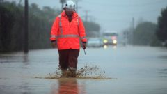 Rural fire chief Colin Eggers makes his way through floodwater in Riwaka after Cyclone Gita hit the town near Nelson hard. (Photo / Tim Cuff)