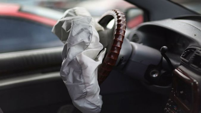 A deployed airbag is seen in a Chrysler vehicle (Photo \ Getty Images)