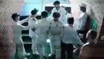CCTV  shows teammates having to restrain Warner in off-field row