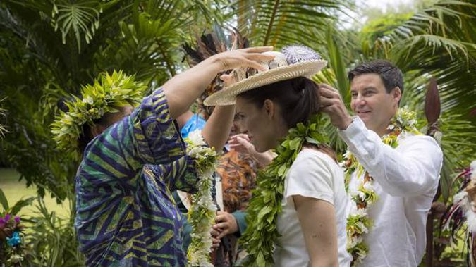Prime Minister Jacinda Ardern, with her partner Clarke Gayford, is welcomed at House of Ariki. (Photo / Michael Craig)