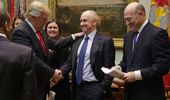 Chris Liddell shakes hands with Donald Trump in 2017. (Photo / Getty)