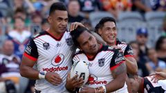Solomone Kata (right) of the Warriors is congratulated after scoring a try in round one. (Photo / AAP)