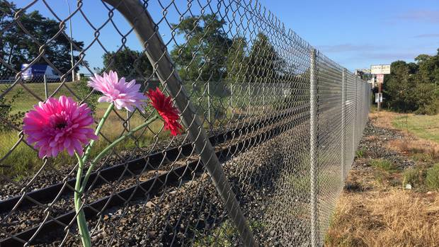 Flowers at the scene of where an 11-year-old was killed by a train in Ngaruawahia on Sunday. (Photo / Belinda Feek)