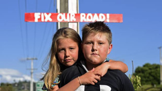 'Fix our road': Residents plead for help as kids left 'traumatised' by crash