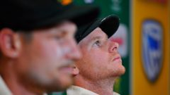 Cameron Bancroft (foreground) and Steve Smith (in focus) have admitted to ball tampering in their 322-run loss to South Africa. (Photo \ Getty Images)