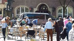 People in front of a restaurant in Münster, Germany, after a vehicle crashed into a crowd killing three. (Photo: AP)