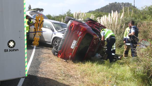 Emergency services at the scene of a crash at Waipapakauri, in the Far North, last Friday. (Photo / Northern Advocate)