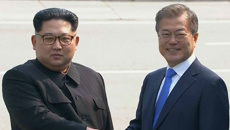 The Koreas come together - Kim, Moon shake hands
