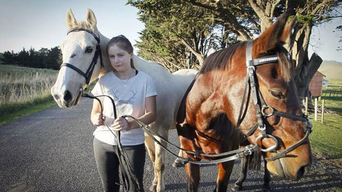 Keiasha McGhie who is being harassed by drones when riding her horses. LR Stan Georgie. The horses have been traumatised (Photograph / Warren Buckland)