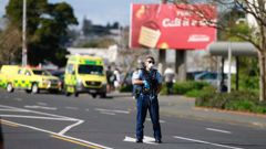 A police officer outside LynnMall in west Auckland after an incident at Countdown. (Photo / Alex Burton)