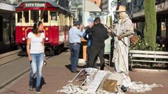 Christopher Ian Truscott has taken up busking in the central city, calling himself Statue Man. (Photo / Star.kiwi)