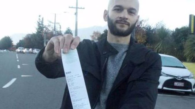 Marco Adreani with one of the tickets he has been issued in Queenstown. (Photo / Mandy Cooper)