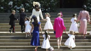 Britain's Prince George, left, Princess Charlotte, third left, Kate, the Duchess of Cambridge, background fourth left and Jessica Mulroney foreground arrive with the bridesmaids, page boys. (Photo / AP)