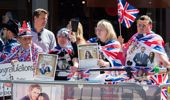 Hundreds and thousands of people lined the streets of Windsor to catch a glimpse of the royal couple. (Photo / Getty)
